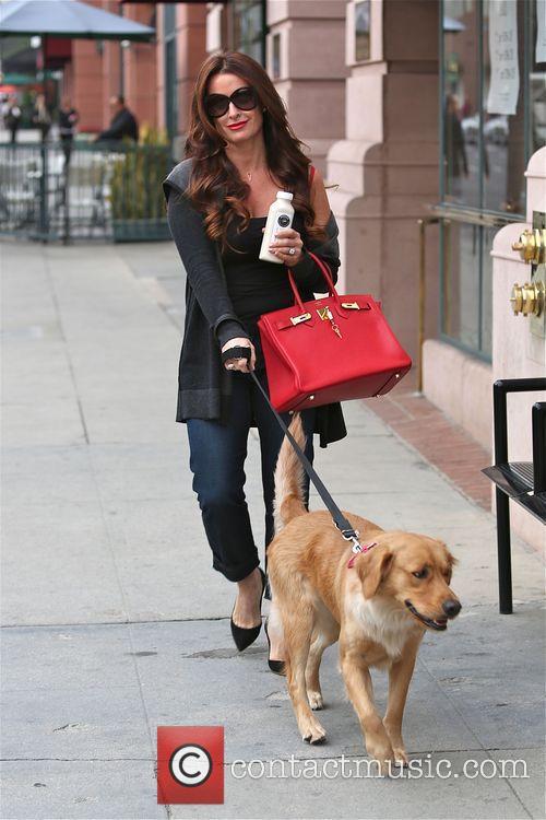 Kyle Richards walks her dog