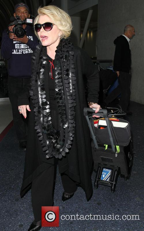 Joan Rivers arrives at Los Angeles International (LAX)...
