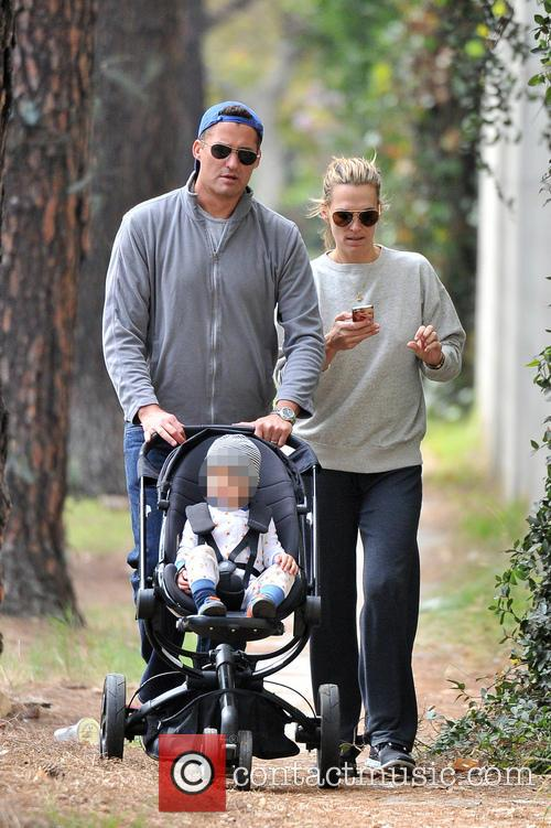 Molly Sims and Scott Stuber out with their...