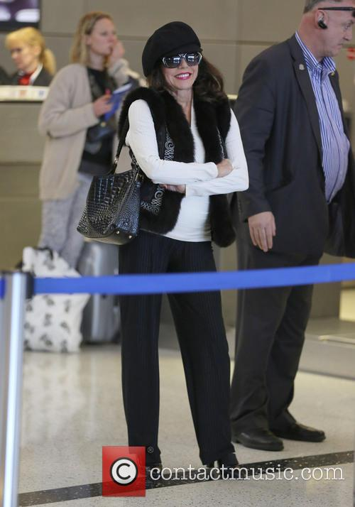Joan Collins and Percy Gibson at LAX