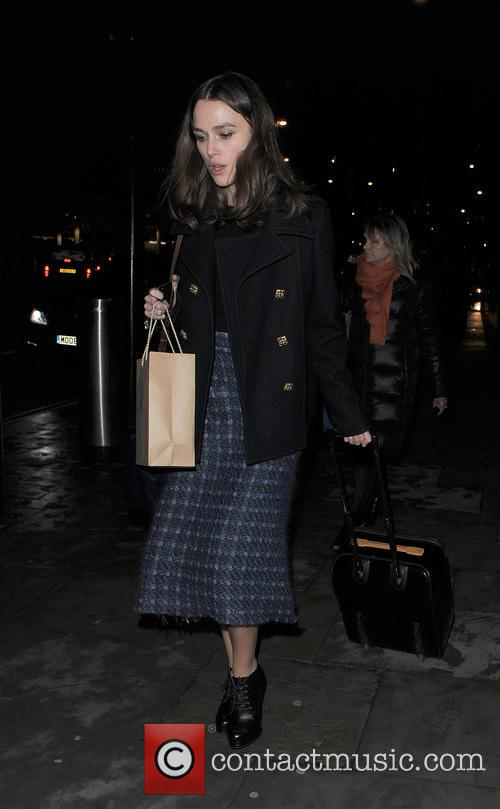 Keira Knightley makes her way through the Eurostar terminal to a waiting car, having arriving back in England on a train from Paris