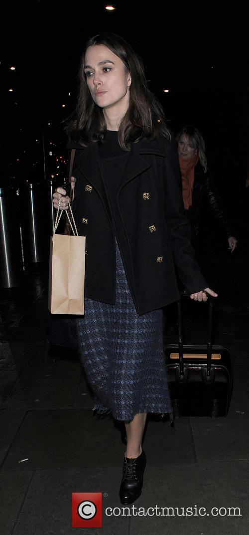Keira Knightley makes her way through the Eurostar...