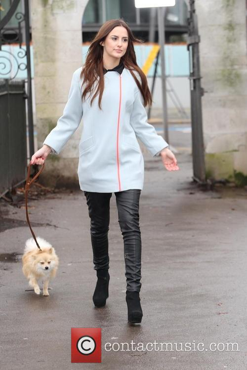 Lucy Watson walks a dog in Battersea