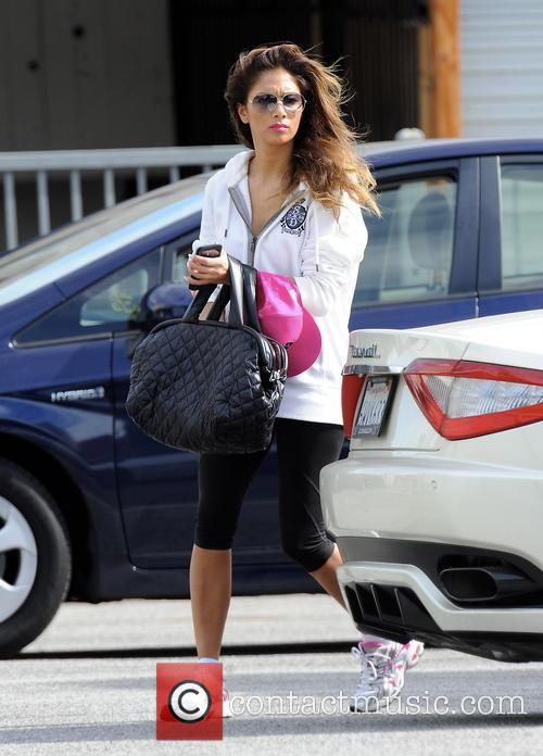 Nicole Scherzinger goes for an early morning workout at SoulCycle West Hollywood, before meeting a friend at XIV Karats
