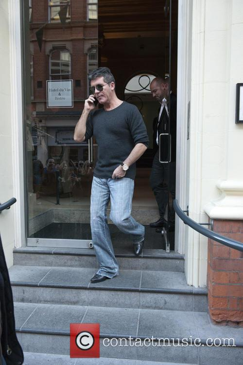 Simon Cowell leaves his hotel for the Britain's...