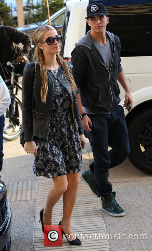 Paris Hilton and her boyfriend, River Viiperi arrive...