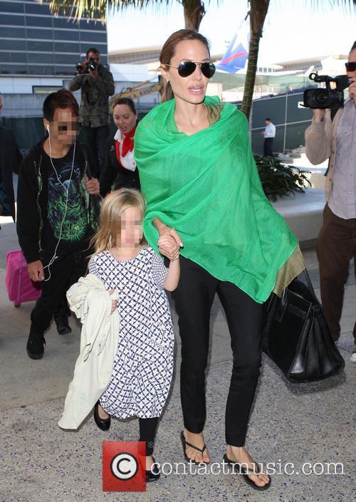Brad Pitt, Angelina Jolie and family at LAX