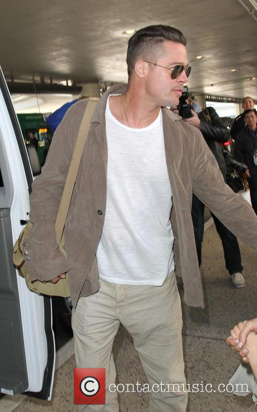 Brad Pitt and Angelina Jolie arriving at LAX...