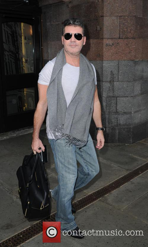 Simon Cowell leaves his Manchester hotel