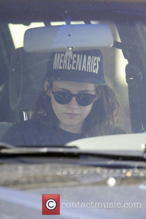Kristen Stewart driving around Hollywood