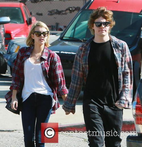 Emma Roberts and Evan Peters walk