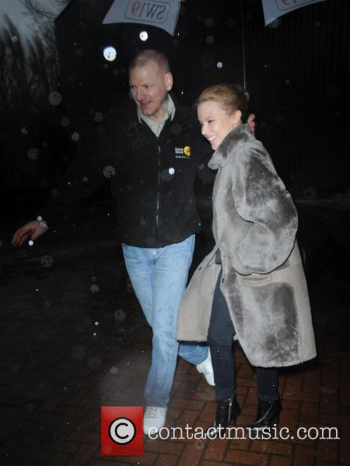 Kylie Minogue arrives in pouring rain
