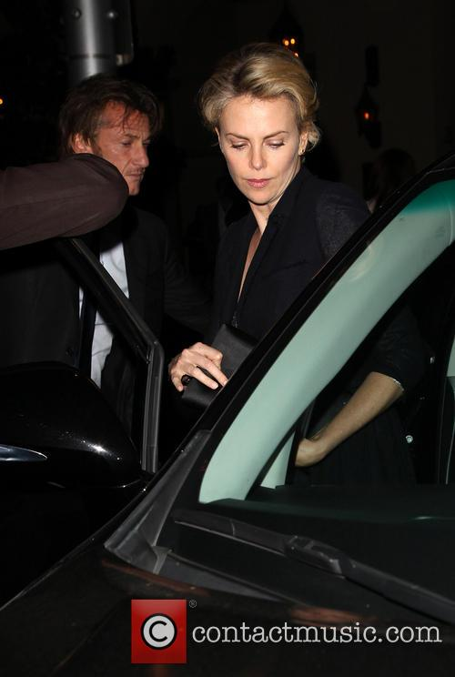 Charlize Theron and Sean Penn leaving a restaurant...