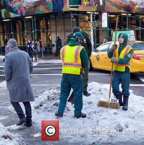 New Yorkers navigate melting snow on the streets...
