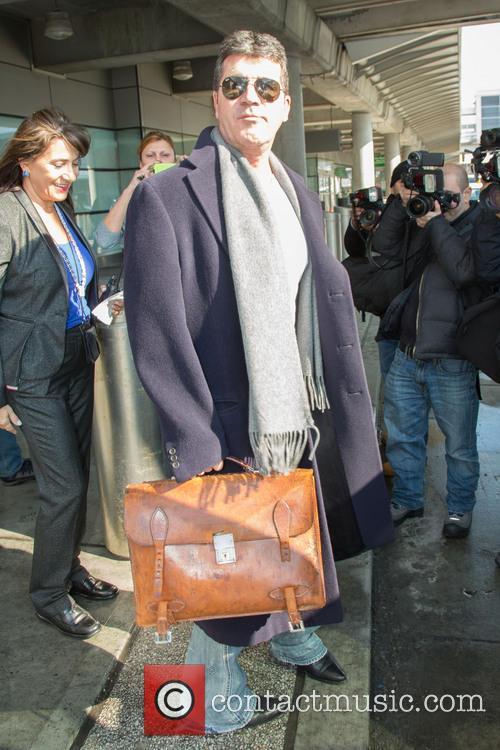 Simon Cowell arrives in New York City
