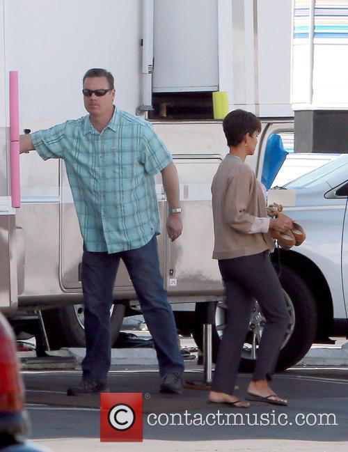 Halle Berry's bodyguard is spotted holding her son, Maceo Robert Martinez, in a baby car seat on set