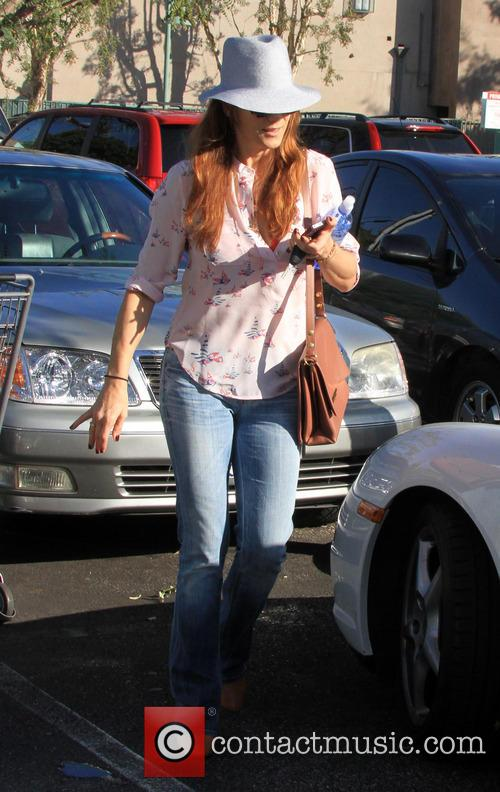 Kate Walsh returns to her car with groceries