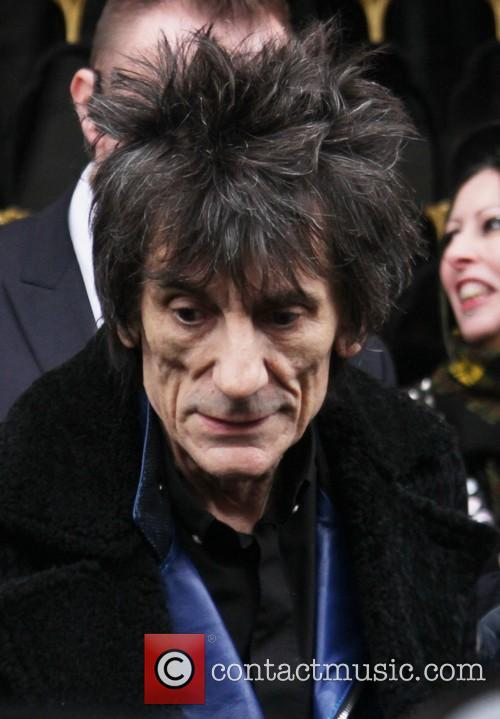 Ronnie Wood leaves a hotel in Paris