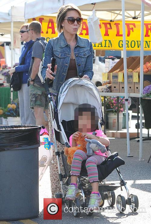 Lisa Joyner takes her daughter to the Farmers...
