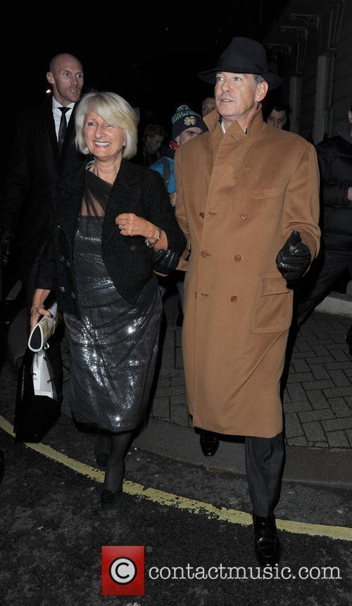 Pierce Brosnan walking in Mayfair with a female companion