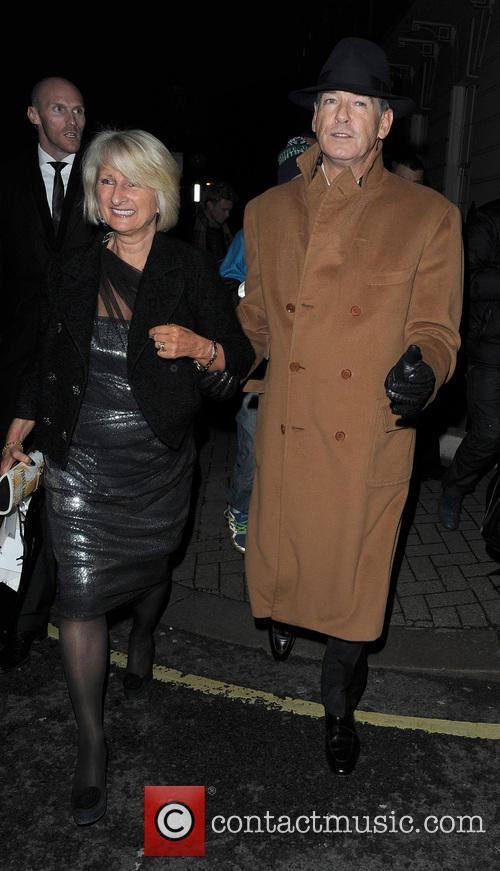Pierce Brosnan walking in Mayfair with a female companion