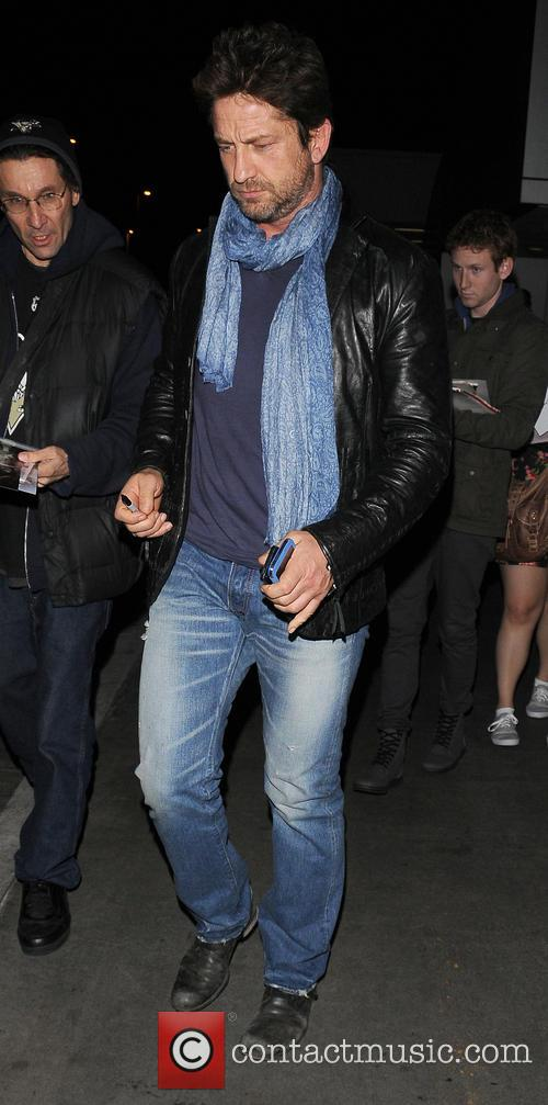 Gerard Butler arrives at Los Angeles International (LAX)...
