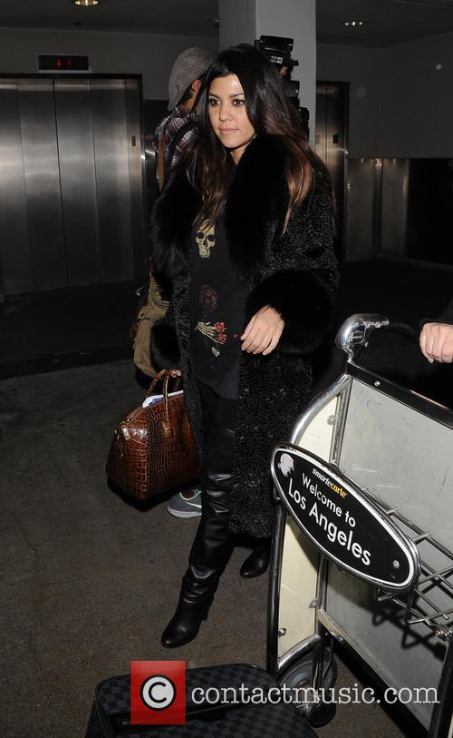 Khloe and Kourtney Kardashian arrive at LAX