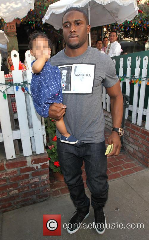 Reggie Bush and family having lunch at The...