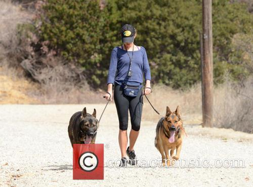 Nikki Reed walks the dogs