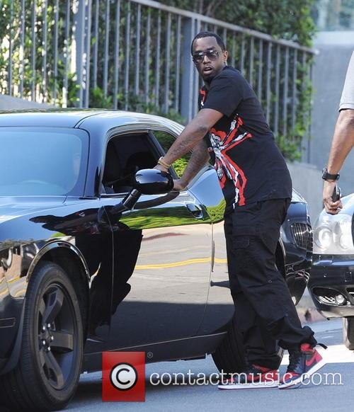 Sean Combs chats up a woman in the middle of the street