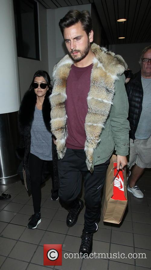 Kourtney Kardashian and Scott Disick arrive at LAX