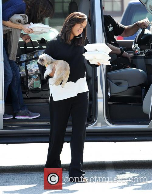 Pregnant Kerry Washington carries her dog during a...