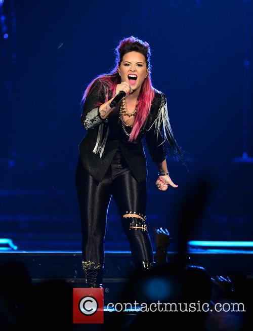 Demi Lovato performing live in concert