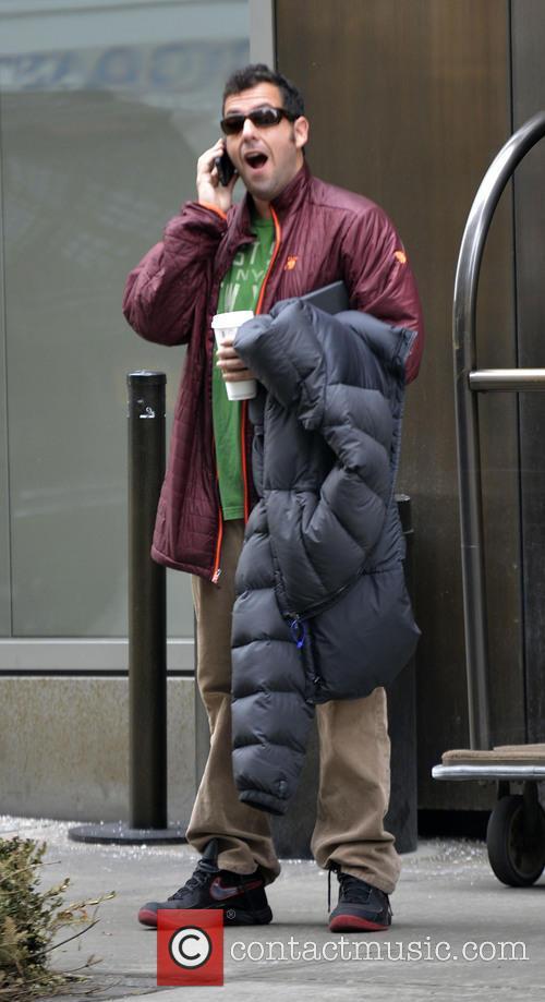 Adam Sandler leaving his hotel