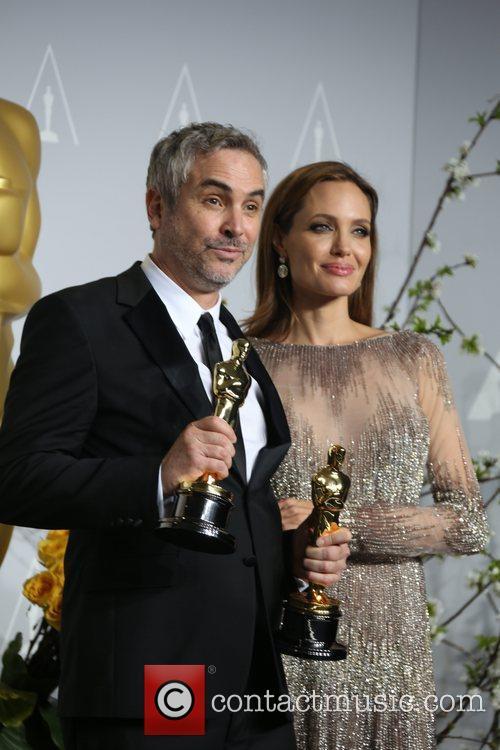 Alfonso Cuaron and Angelina Jolie 2