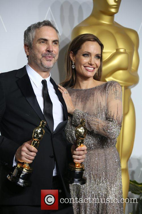 Alfonso Cuaron and Angelina Jolie