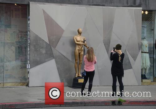 LA street artist installs Oscars drug statue on...