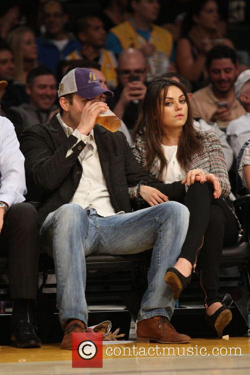 Ashton Kutcher and Mila Kunis 7