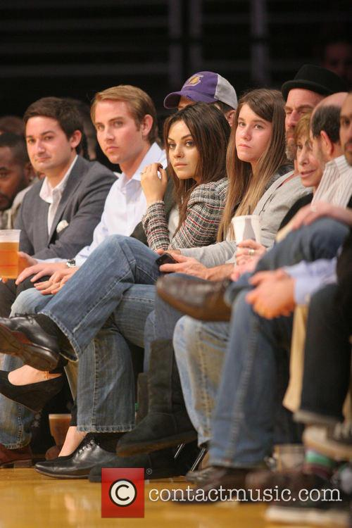 Celebrities courtside at the Los Angeles Lakers v...