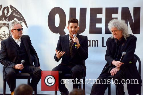 Roger Taylor, Adam Lambert and Brian May 11