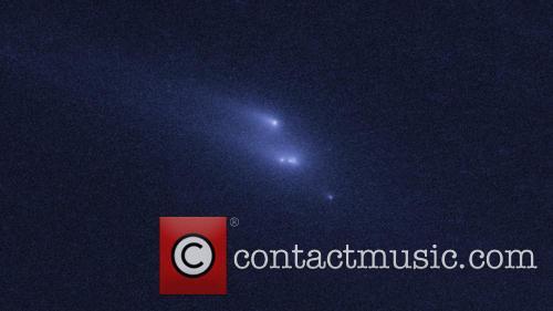 Hubble Witnesses Asteroid Breakup 6