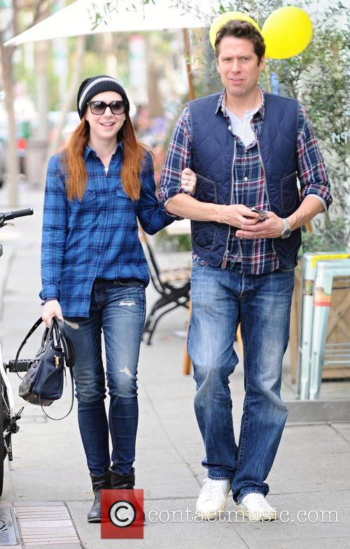 Alyson Hannigan and husband Alexis Denisof take a...