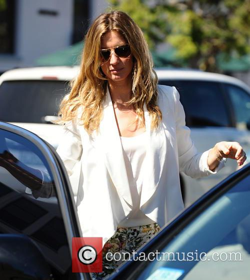Gisele Bundchen and Tom Brady leave St. Monica's Church