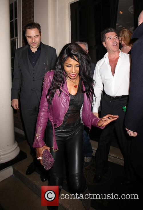 Simon Cowell and friends leaving The Arts Club