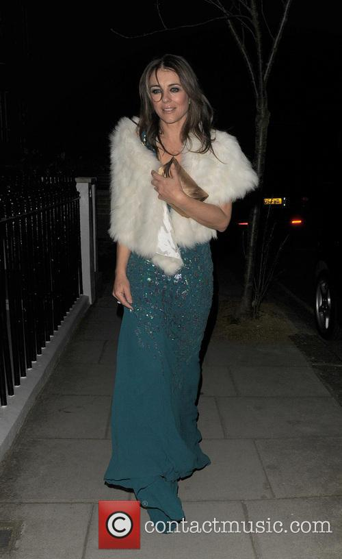 Elizabeth Hurley leaves Claridges hotel with a male companion, and heads to Blakes hotel in Fulham