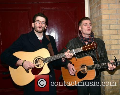 Hudson Taylor busk outside The Gaiety Theatre