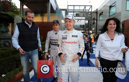 Kevin Magnussen and Nico Rosberg 11