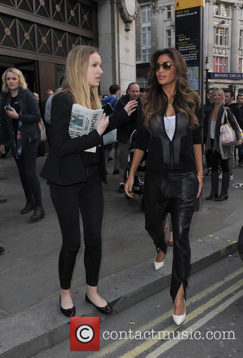Nicole Scherzinger suprises commuters and tourists at Oxford Circus tube station