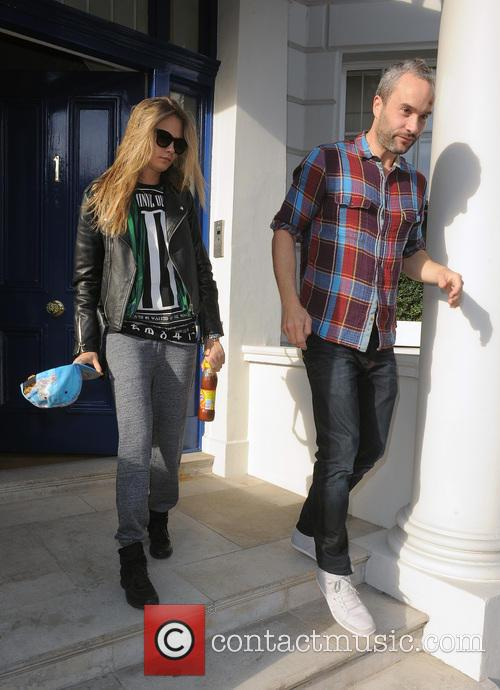 Cara Delevingne leaving her home with a male companion