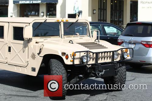 Arnold Schwarzenegger and Ralf Moeller are  leaving Le Pain Quotidien cafe at the Brentwood with his Hummer H1